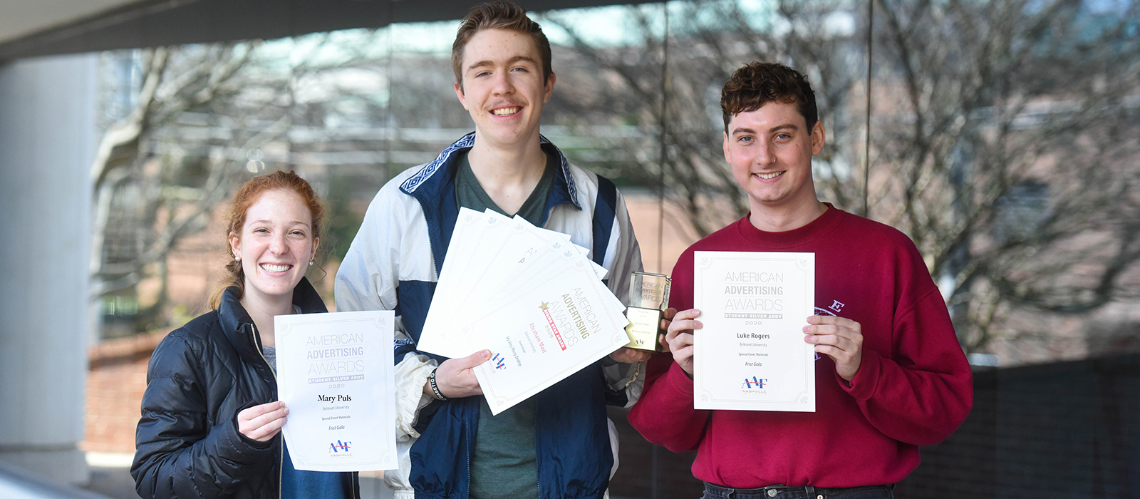 Three students with their Addy awards.