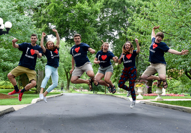 Students jumping for in the air excitedly wearing I heart Belmont shirts