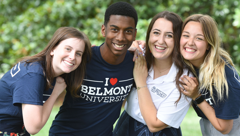 A photo of Belmont students pose for a photo in their Belmont orientation shirts.