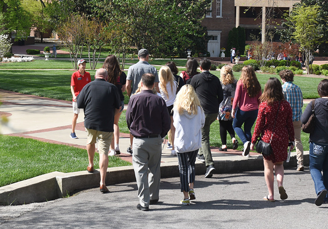Students following a tour guide on a campus tour