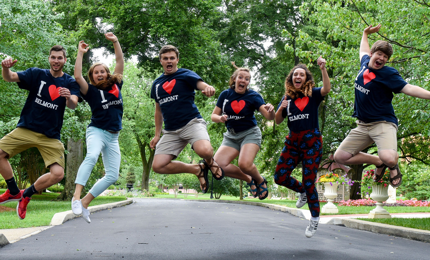 Students jump in excitement on the main quad of Belmont's campus.
